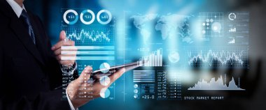 Investor analyzing stock market report and financial dashboard with business intelligence (BI), with key performance indicators (KPI).businessman hand working with finances program on wide screen computer.