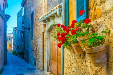 View of a narrow street in the spanish town Valldemossa at Mallorc