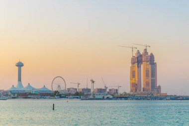 Sunset view over Abu Dhabi marina with the Marina mall and the Marina eye.