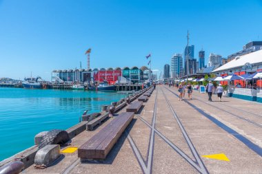 AUCKLAND, NEW ZEALAND, FEBRUARY 20, 2020: People are strolling on a waterfront of port of Auckland, New Zealand