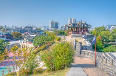 SUWON, KOREA, OCTOBER 24, 2019: Banghwasuryujeong Pavilion and Hwahongmun gate at Suwon, Republic of Korea