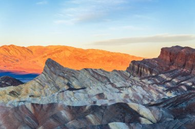 Famous Zabriskie Point at sunset in Death Valley National Park.C