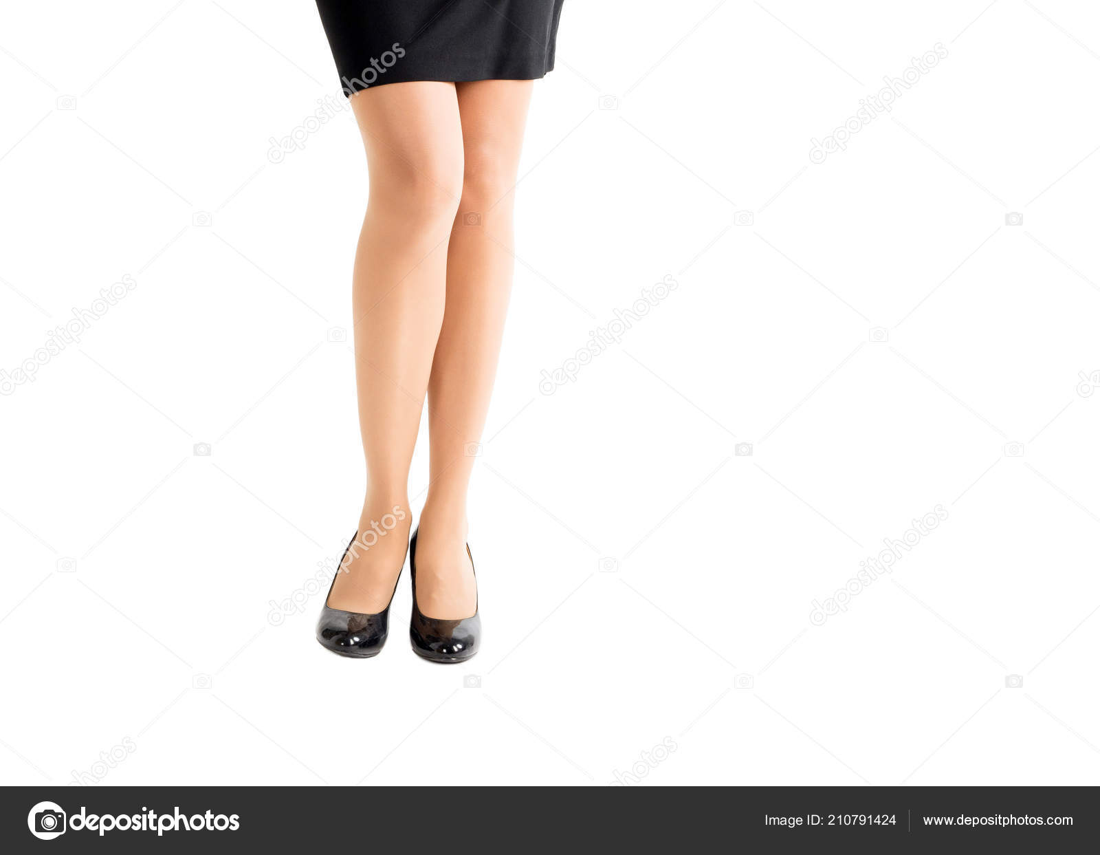 d394a37189f Beautiful female legs in classic black heel shoes and skin color tights