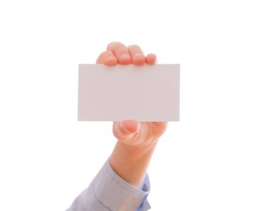 Child's hand showing an empty business card, isolated on white