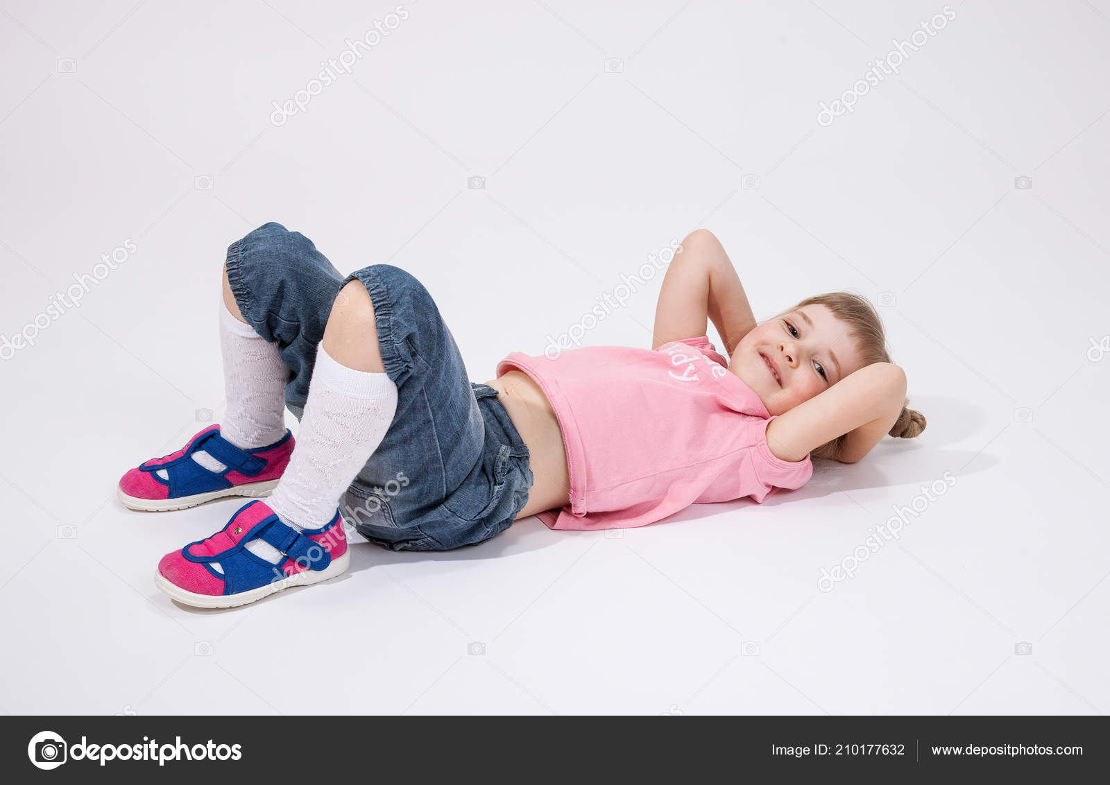 Smiling Little Girl Lying Floor White
