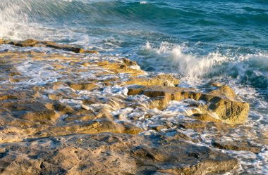 Scenic view of Mediterranean sea waves splashing on rocks stock vector