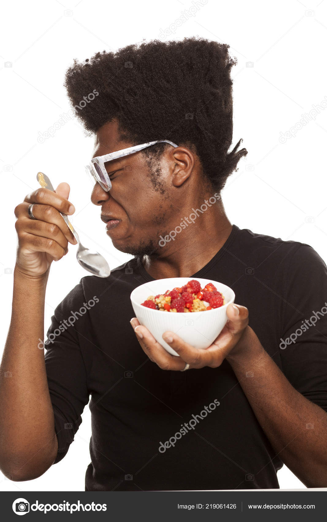 3c17a0e9c97 Disgusted Young Handsome Afro American Hipster Guy Eating Cereals ...