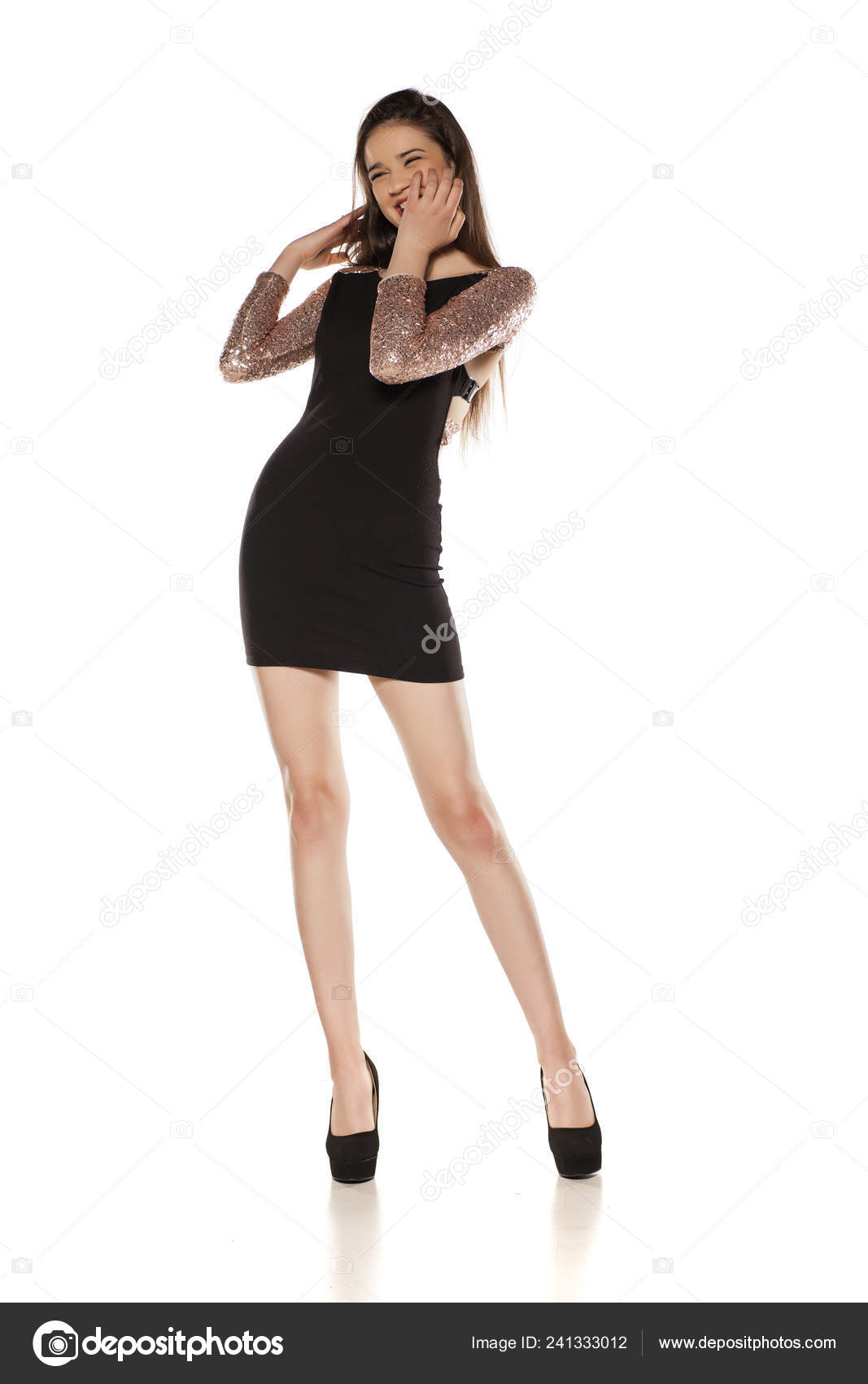 1411bad0e Happy young girl in tight black dress and high heels posing on a white  background — Photo by ...