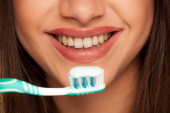 Fotografie young woman holding  tooth brush with toothpaste