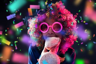 happy woman wearing color wig with party items