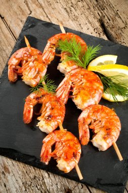 Grilled tiger shrimps with spices and lemon