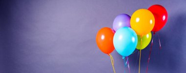 Colorful balloons on the grey background