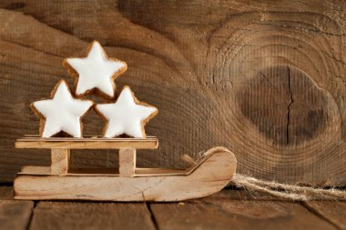 Christmas spices and stars still life with delicious star-shaped cookies, background