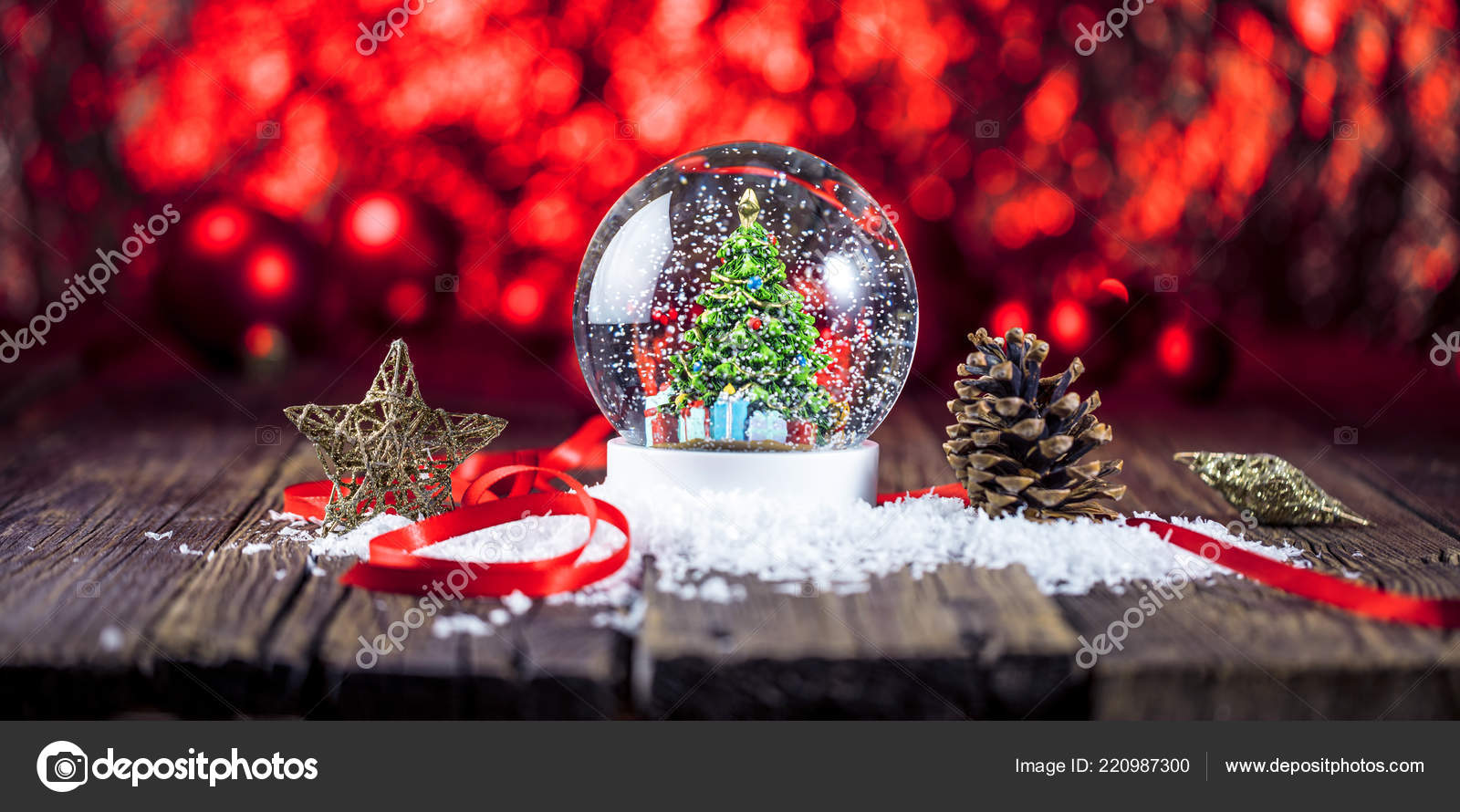 Boule De Neige Noel christmas snow globe wooden background — stock photo