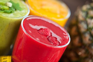 Colorful smoothie, healthy detox vitamin diet or vegan food concept, fresh vitamins, breakfast drink