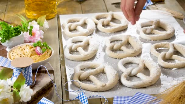 cropped shot of person cooking delicious pretzels in kitchen