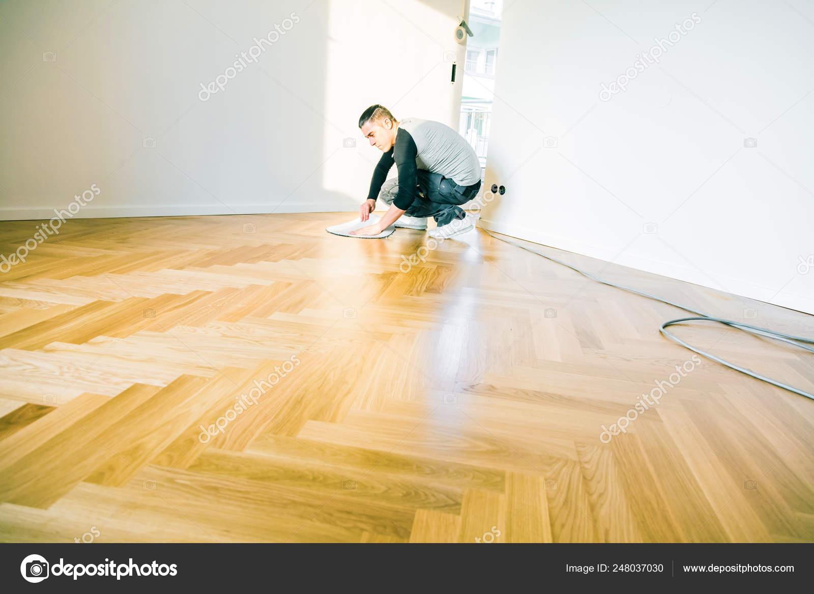 Man Varnishing Oak Parquet Floor Stock Photo C Karepastock