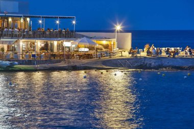 People dinning at the beach. Mediterranean coastline in Spain. Chillout