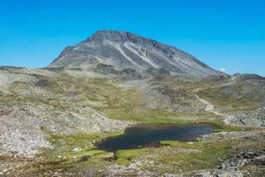 Besseggen ridge with little lake in Jotunheimen National Park, Norway