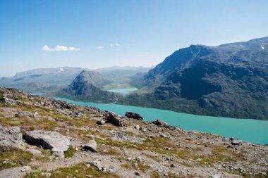 Besseggen ridge over Gjende lake in Jotunheimen National Park, Norway stock vector