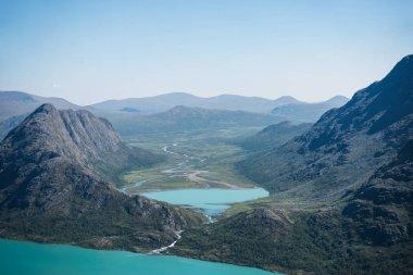 Besseggen ridge over blue Gjende lake in Jotunheimen National Park, Norway stock vector