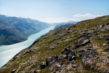 Scenery Besseggen ridge over Gjende lake in Jotunheimen National Park, Norway stock vector