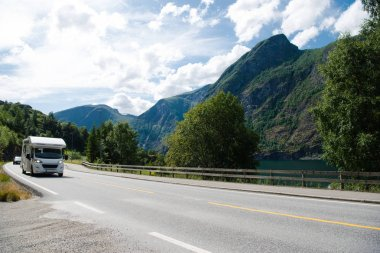 AURLANDSFJORD, FLAM, NORWAY - 27 JULY, 2018: cars on road in Aurlandsfjord, Flam (Aurlandsfjorden), Norway stock vector
