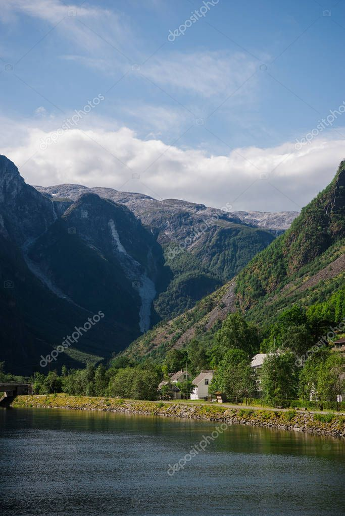 houses and green trees near majestic mountains, Gudvangen, Neirofjord, Norway