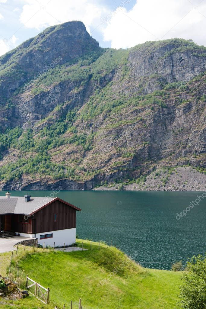 cozy wooden house on coast of beautiful Aurlandsfjord, Flam (Aurlandsfjorden), Norway