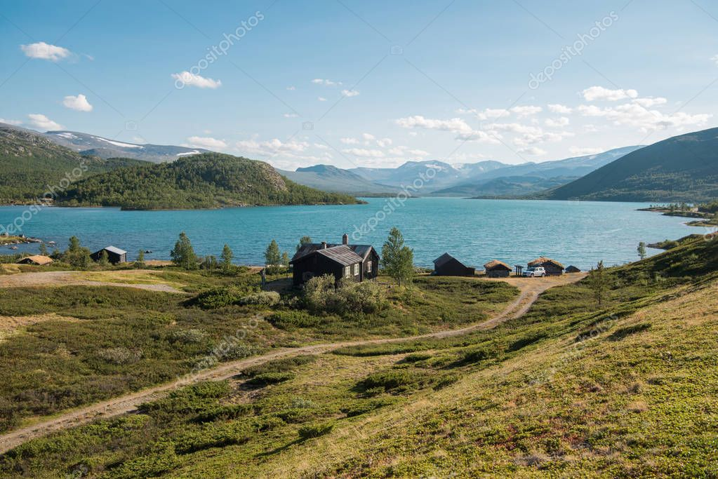 wooden buildings in cozy village at Gjende lake, Besseggen ridge, Jotunheimen National Park, Norway