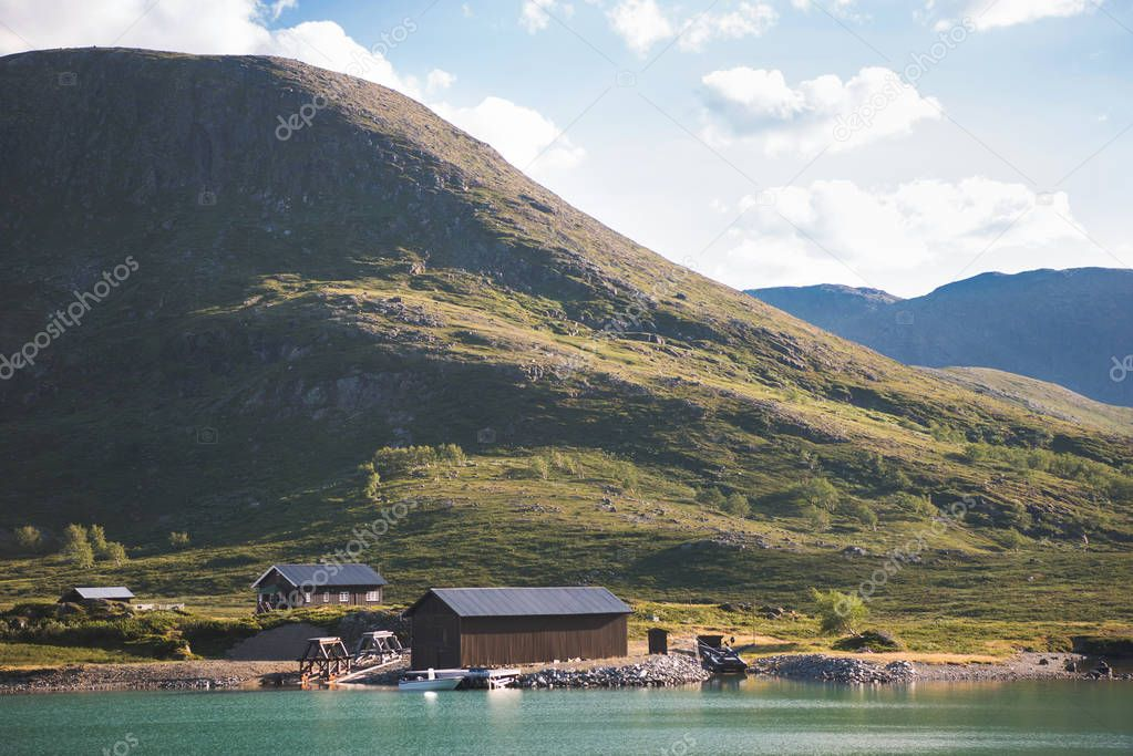 houses and moored boat at Gjende lake, Besseggen ridge, Jotunheimen National Park, Norway