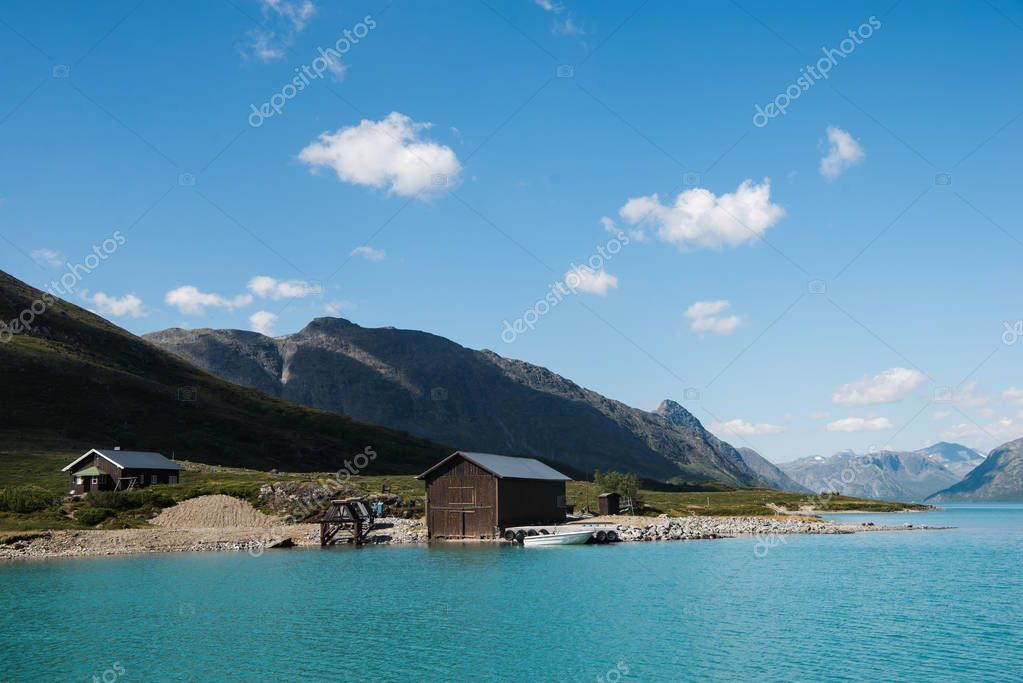 buildings on coast of majestic Gjende lake, Besseggen ridge, Jotunheimen National Park, Norway