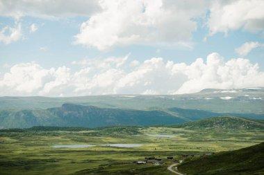 Aerial veiw of hills with green valley under cloudy sky in Hallingskarvet National park, Norway stock vector