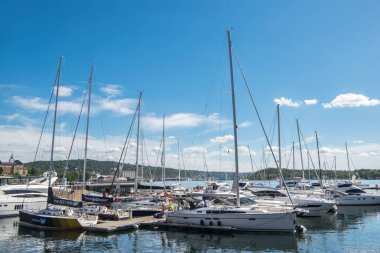 OSLO, NORWAY - 28 JULY, 2018: boats and yachts in harbour at Aker Brygge district, Oslo
