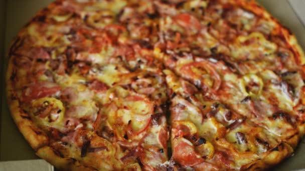 girls hand takes a piece of italian big tasty pizza