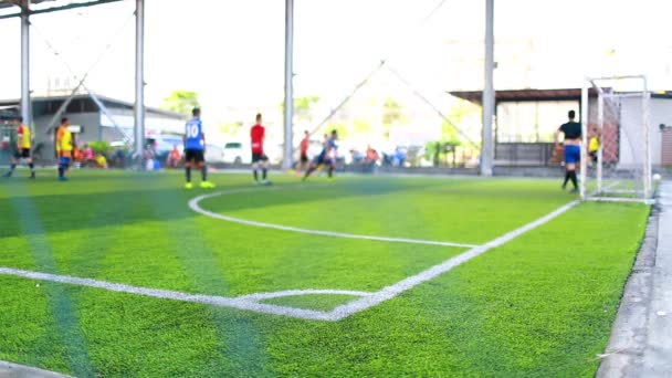 the corner of football field with blurry players background, corner for corner kick with blurry soccer players, soccer training or football match.