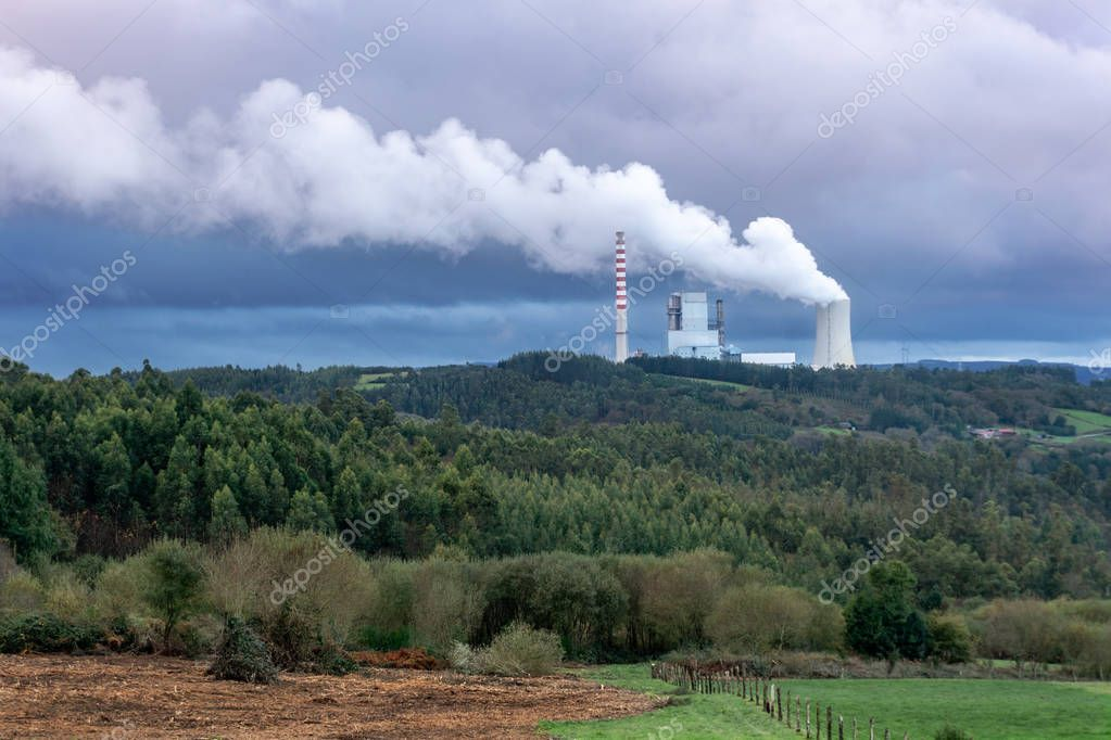 Environmental pollution problem concept. Coal power plant polluting the planet. Thick chimney smoking towards the sky. Meirama coal power plant, Galicia Spain