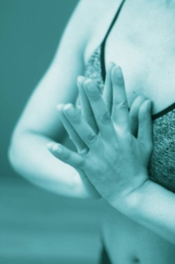 Female instructor yoga teacher teaching asana pose with mudra hand posture.