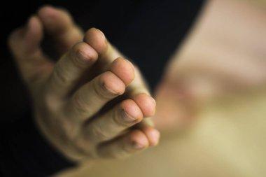 Male instructor yoga teacher teaching asana pose with mudra hand posture.
