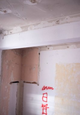 Building renovation works in appartment  renovation works in appartment showing refurbishments works by builders to renovate walls.
