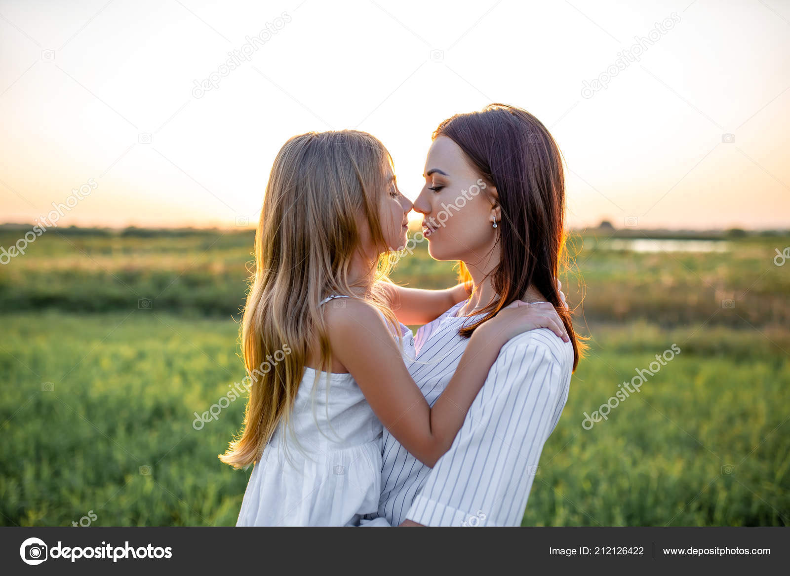 Close Portrait Beautiful Mother Daughter Embracing Touching Noses