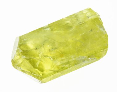 macro photography of natural mineral from geological collection - rough yellow apatite crystal on white background