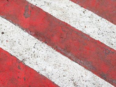 red and white stripes on asphalt road