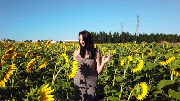 Brunette girl on farm in suburbs in sunflower field. Farming agriculture concept