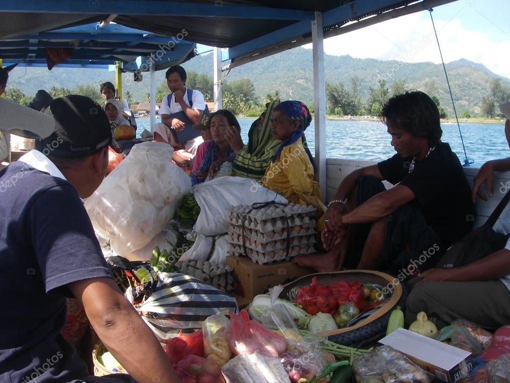 Floating market with fresh vegetable in a boat