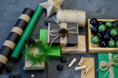 Packing of new kraft paper of the New Year and Christmas gift, green and black. Material for decorating the holiday. Natural decor in the style of eco-style.