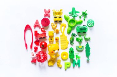 Children's toys rainbow color. Flat lay The collection of games baby. Copy space