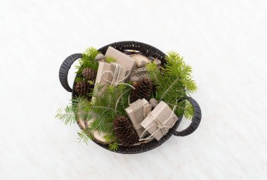 Zero waste Christmas concept. Wicker basket Hand crafted gifts with natural Christmas decorations without plastic. Flat lay, top view