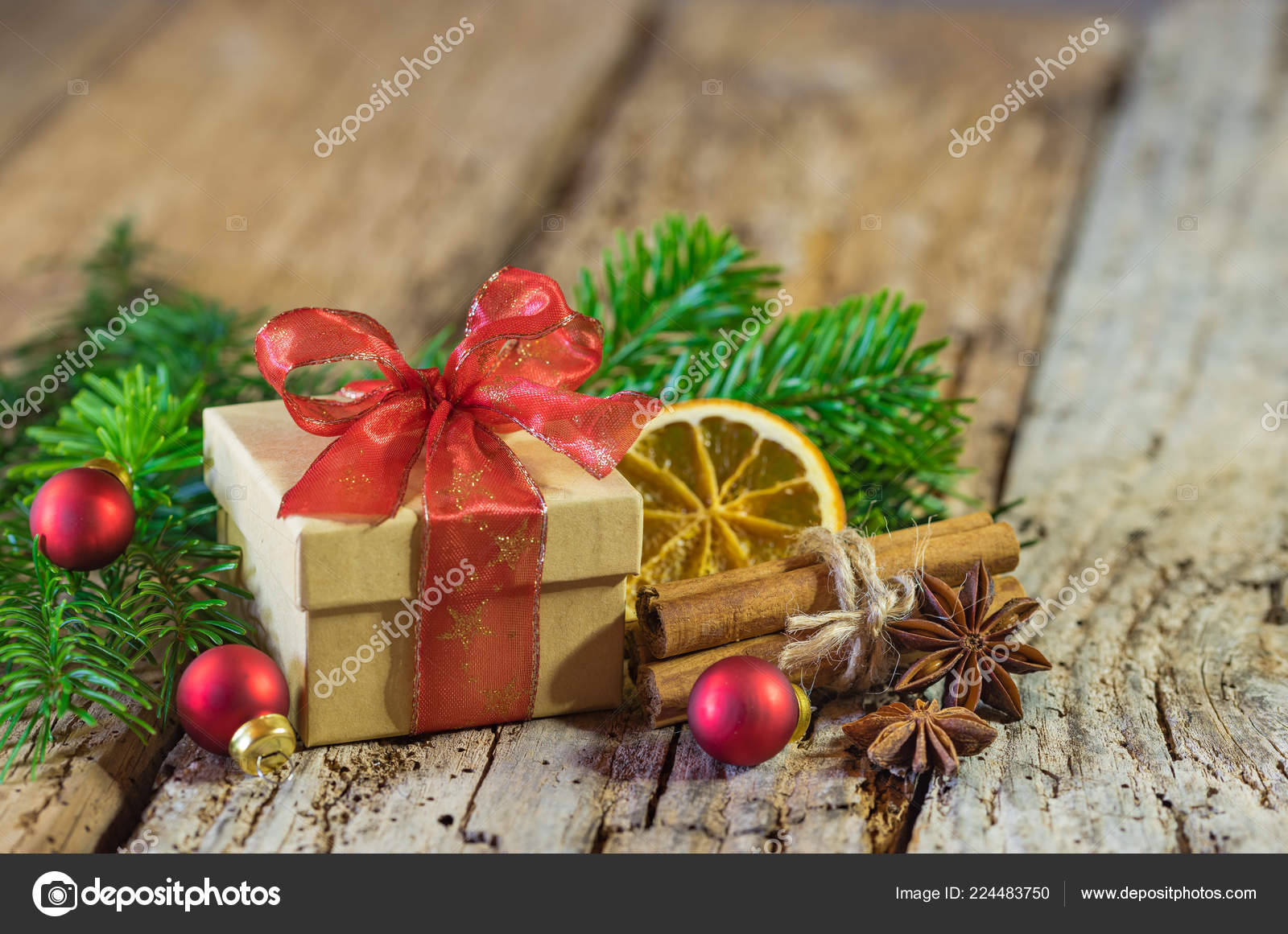 christmas present red ribbon natural decorations wood background stock photo - Christmas Present Decoration