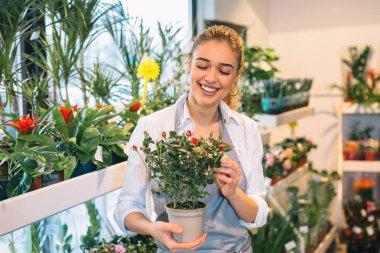 Portrait of woman florist in flower shop.
